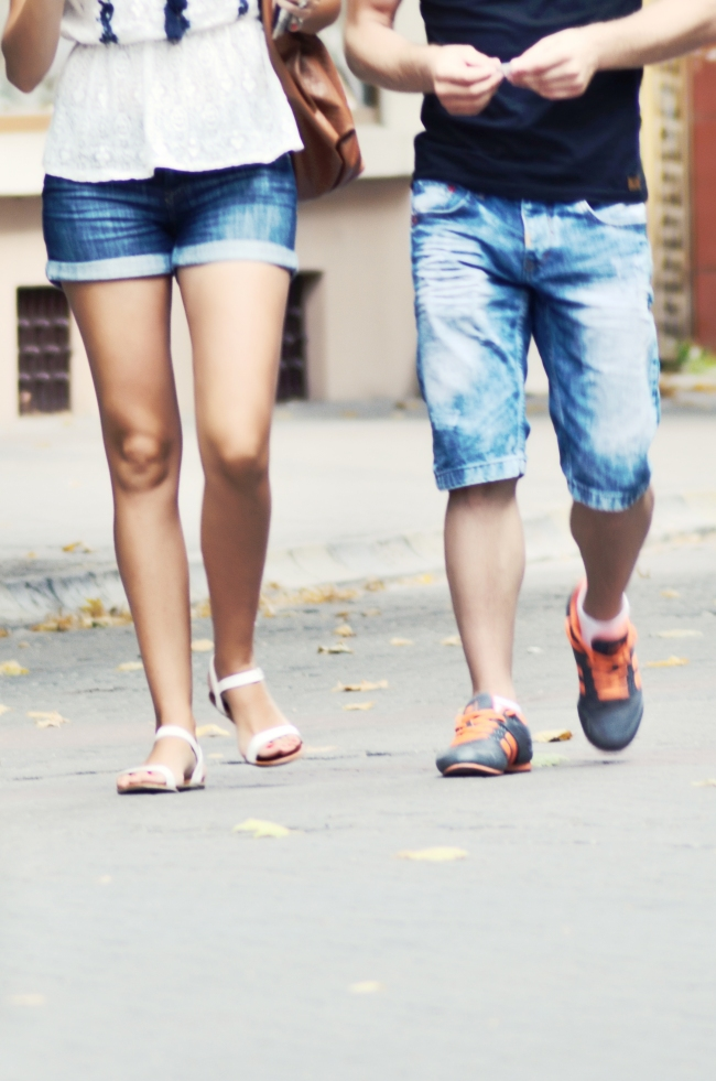 Casual Young Couple Walking on the Street