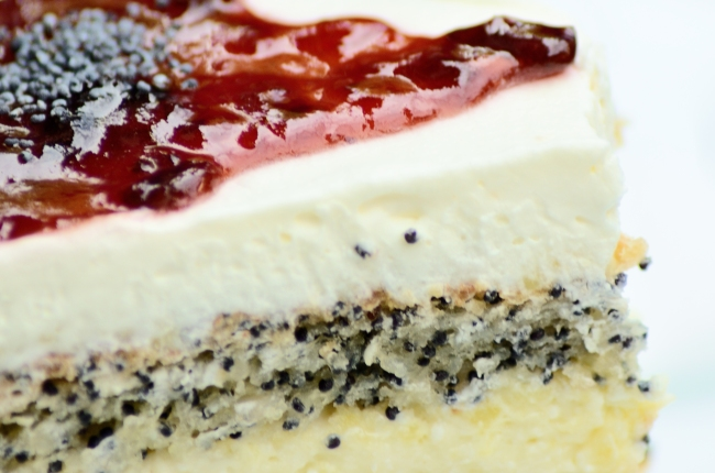 Cheesecake with Cream, Poppy Seeds and Red Topping