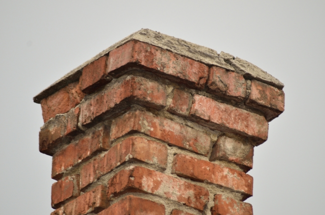 Old Brick Chimney under Open Sky