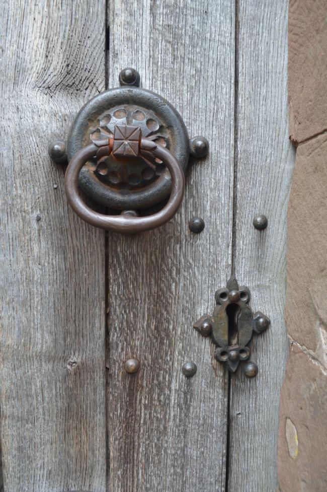 Metal Knob on an Old Wooden Door