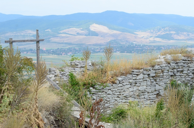 Urban Panorama behind Stone Wall with Dry Grasses