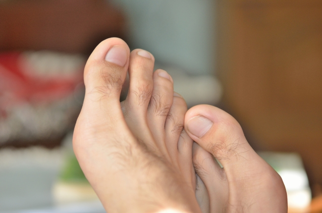 The Toes of a Man from Close Distance