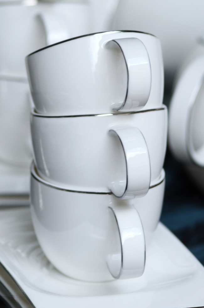 Three White Coffee Cups in a Stack