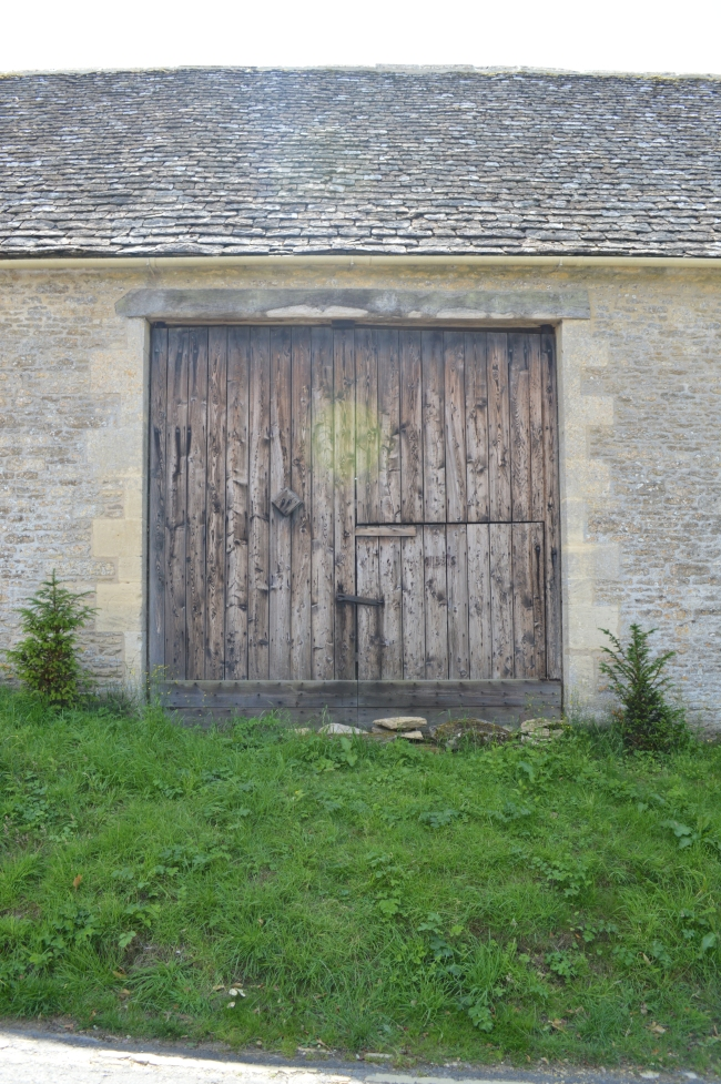 Old Barn with Wooden Door and Grass