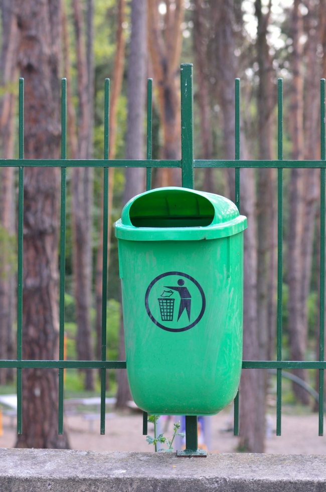 A Green Recycle Bin in a Park