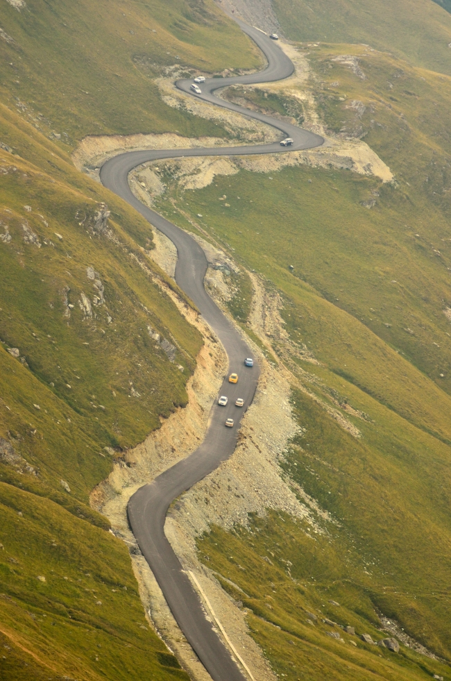 Cars on a Road Winding up a Big Mountain