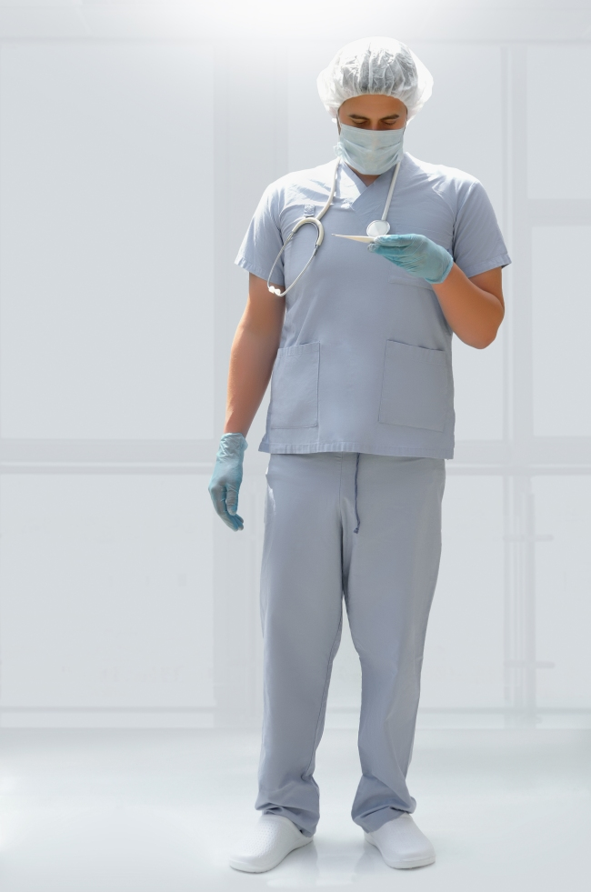 Young Doctor with Stethoscope and Scrubs Standing