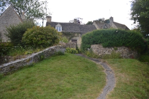 A Stone Path in a Village with Stone Walls