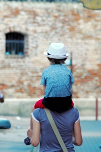 Child on the Shoulders of a Woman