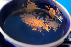 Blue China Cup Holding Water