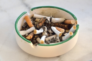 Cigarette Butts in Dirty Ashtray