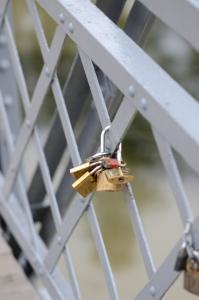 A Few Love Padlocks on Bridge