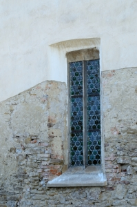 Squared Window with Stained Glass in Stone Wall