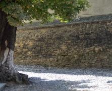 Stone Wall Enclosing Patio
