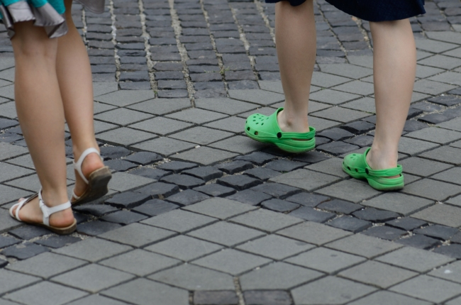 Two Pairs of Feet on the Street