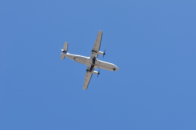 White Airplane Flying on Blue Sky