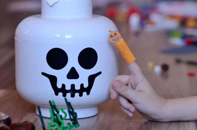 Child Playing Halloween Game with Paper Puppet