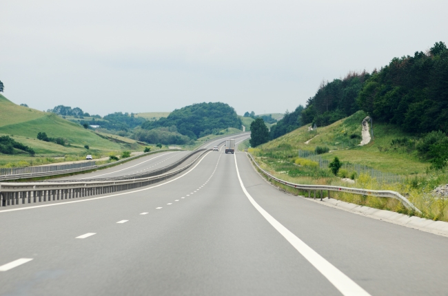 Modern Motorway on Hill with Cars