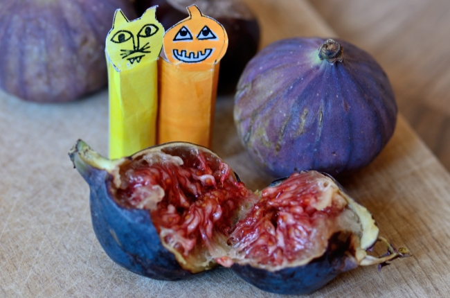 Seeds of Cut Open Fresh Fig with Halloween Paper Characters