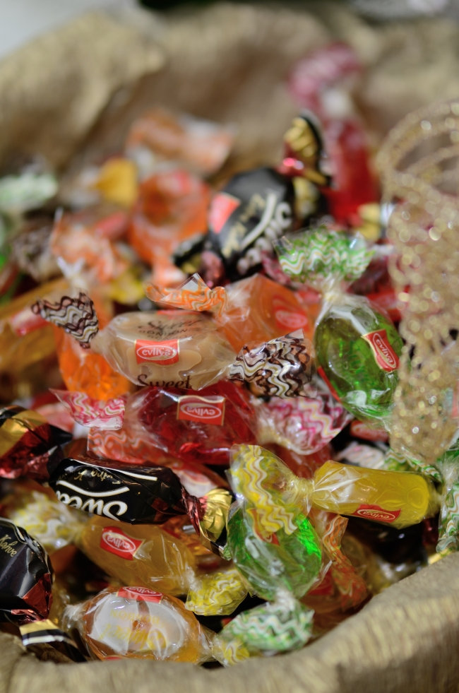 A Variety of Colorful Candies in a Basket