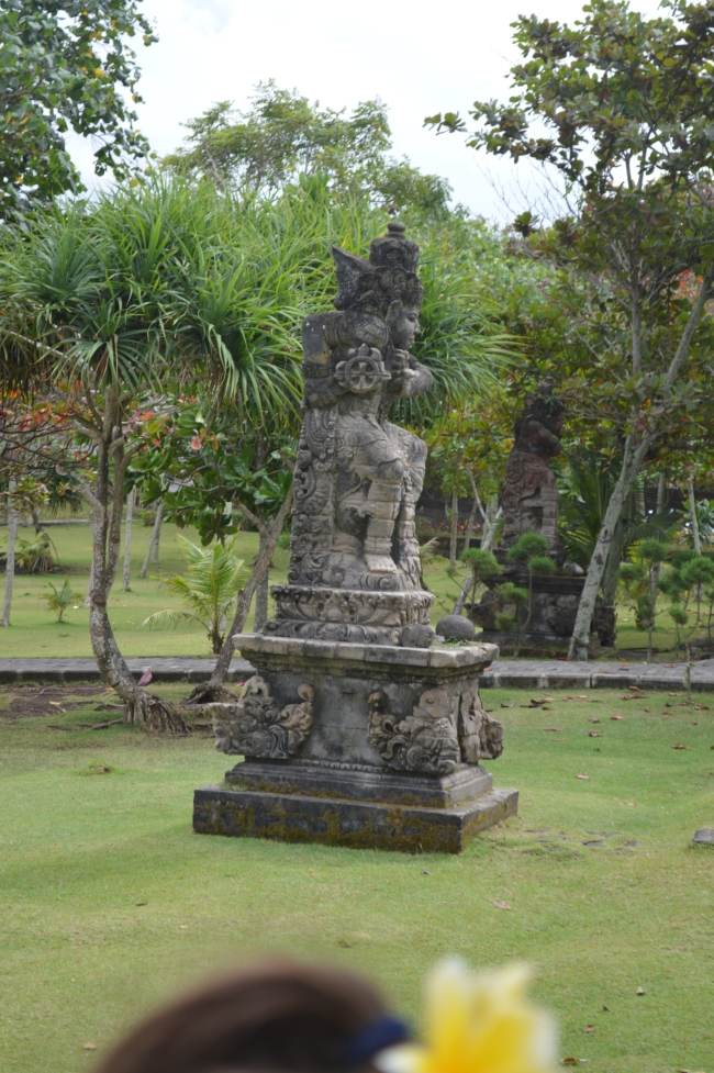 Asian Statue in a Park with Luxuriant Vegetation