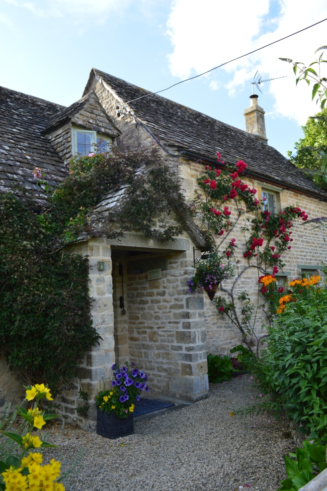Stone House with Colored Flowers