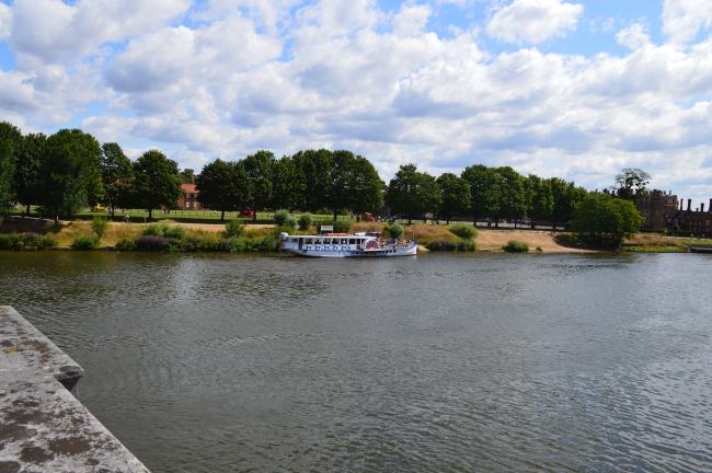 Cruising Boat with Tourists on the Thames River at Noon