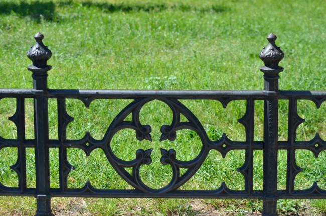 Cast Iron Grey Fence in a Park