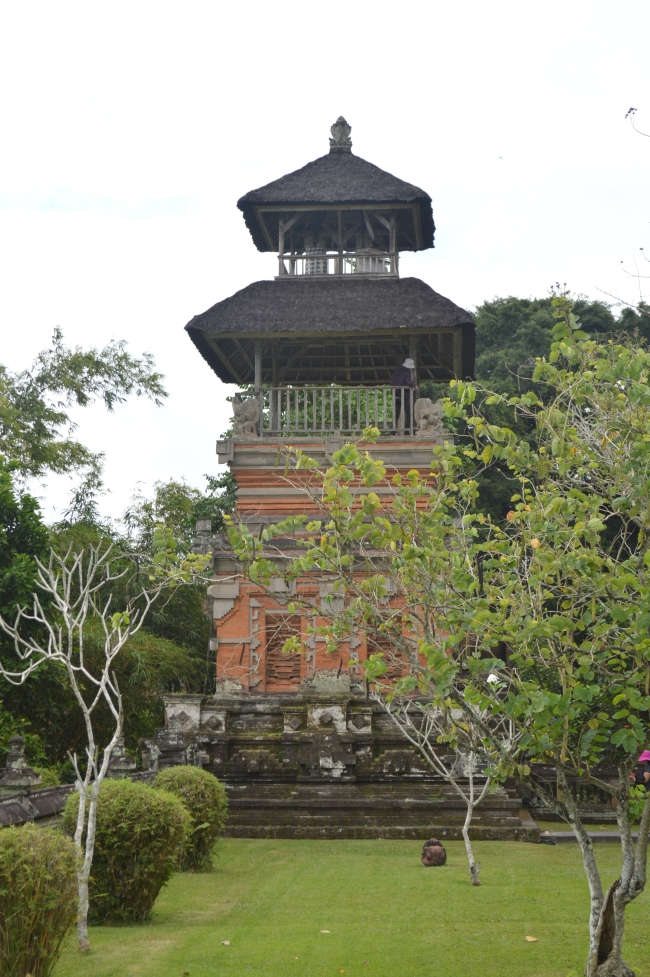 Tower-Like Asian Temple Surrounded by a Garden