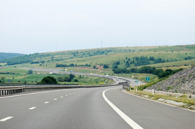 Highway Passing on a Hill with Cars in the Distance