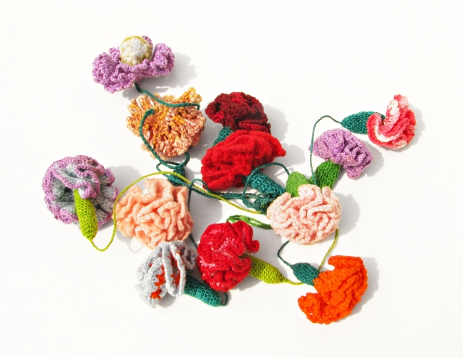Knitted Flowers on a Table