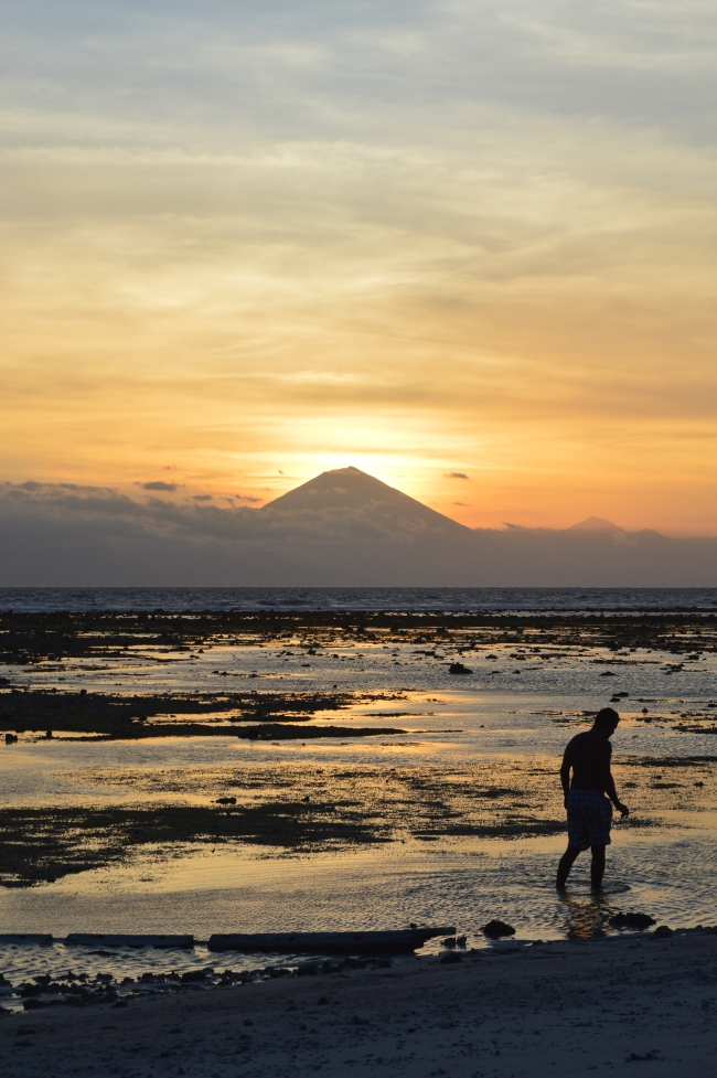 Tourist on the Beach During Low-tide in the Sunrise