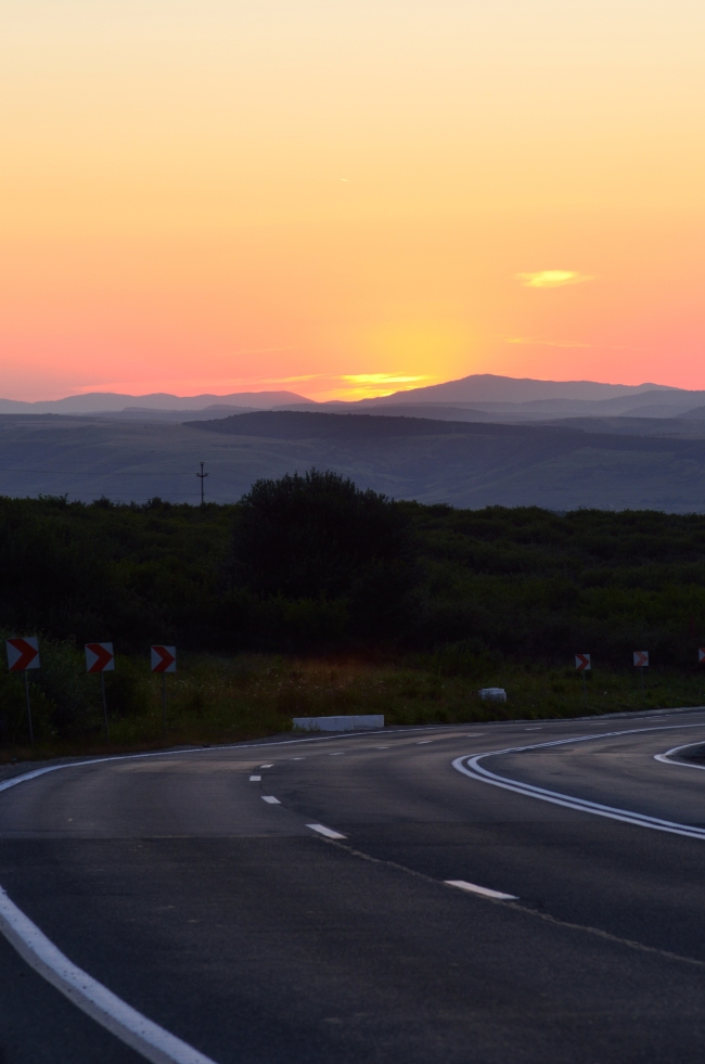 Downhill Open Road at Sunset