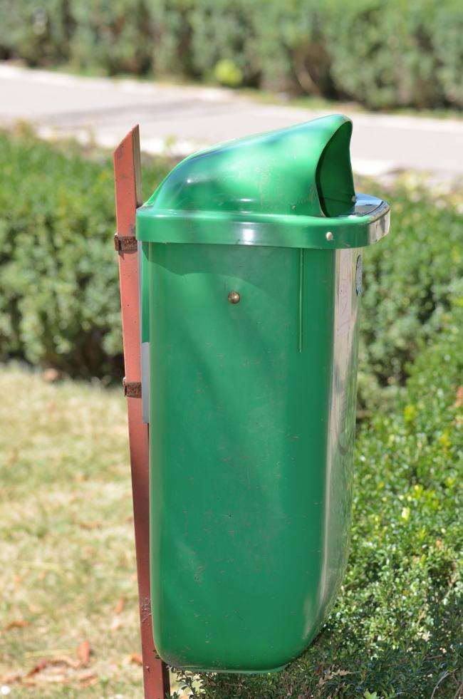 Trash Bin in a Garden
