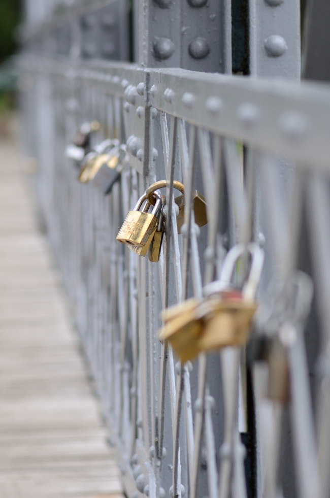 Love Padlocks with Inscriptions on Bridge