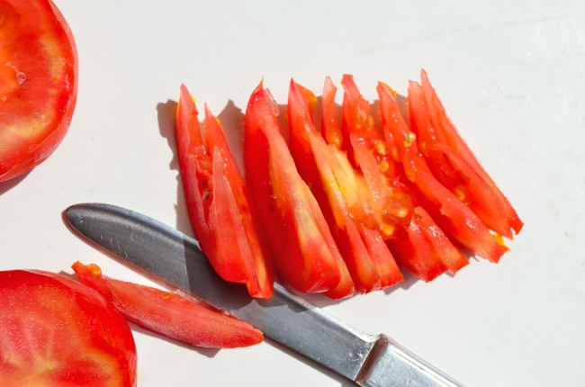 Chopped fresh tomatoes on table.