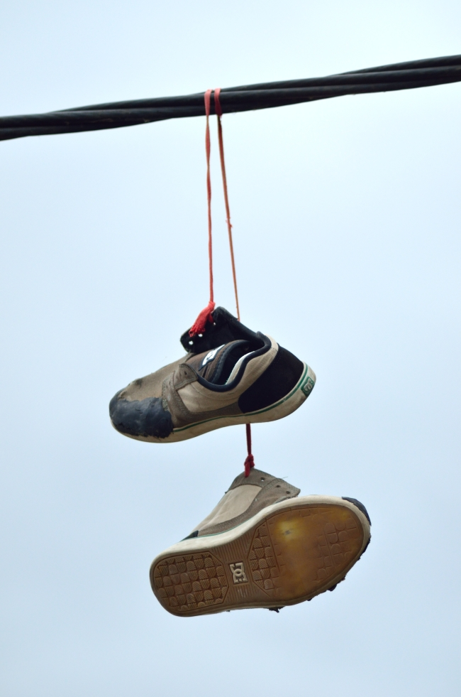 Pair of Sneakers Leashed on Rubber Wire
