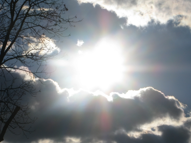 Sunlight Looming through White Clouds