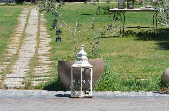 Lamp in the Garden near a Rocky Path