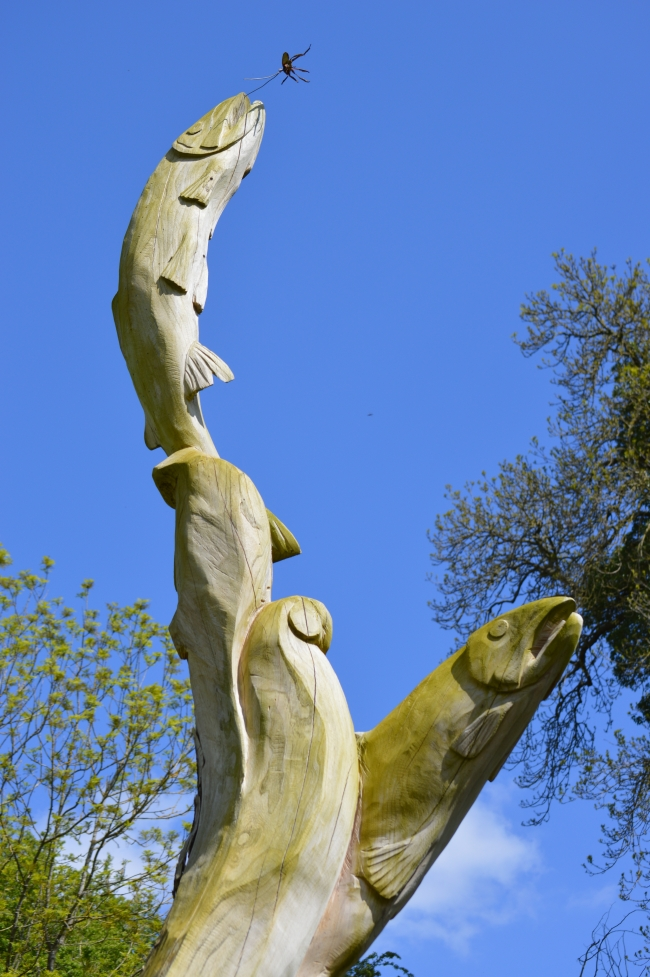 Statue of Two Fish with Blue Sky Above