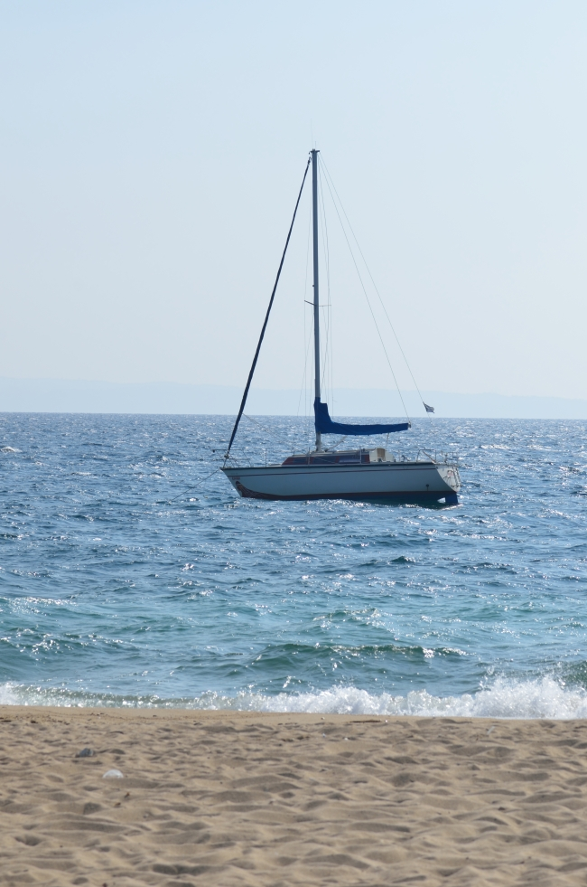White Boat Sailing Near the Shore