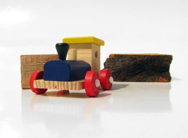 Red, Yellow and Blue Wooden Toy Train