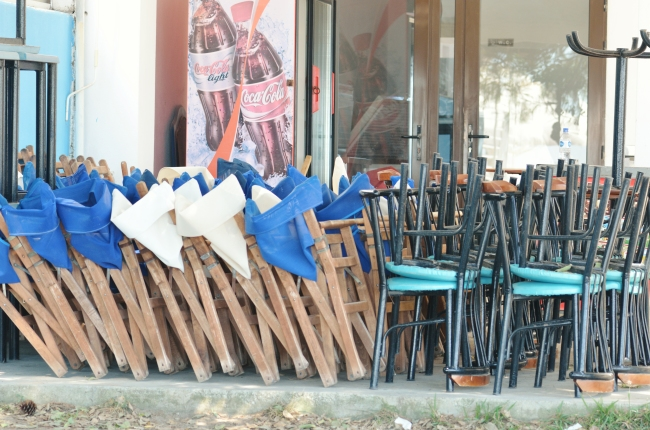 Wooden Chairs at Closing Time