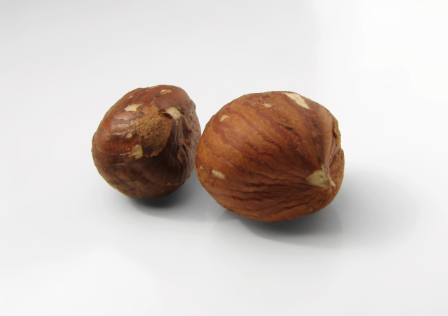 Tasty Hazelnuts on White Table