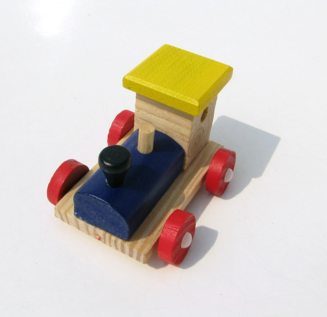 Wooden Toy Train on White Table