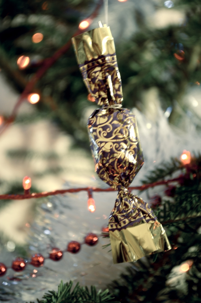 Candy Wrapped in Golden Arabesque Tinfoil
