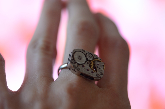 Superb Ring on Finger on Pink Background
