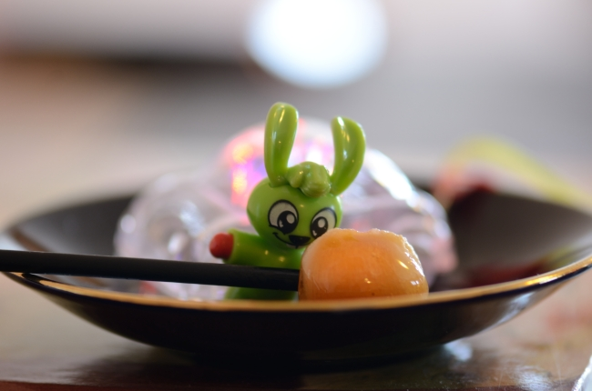 Candy and Plastic Character on Dark Plate