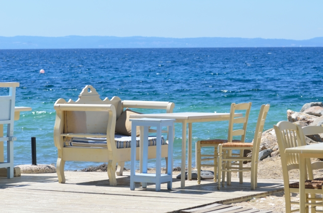 Seaside Terrace with Table and Empty Seats