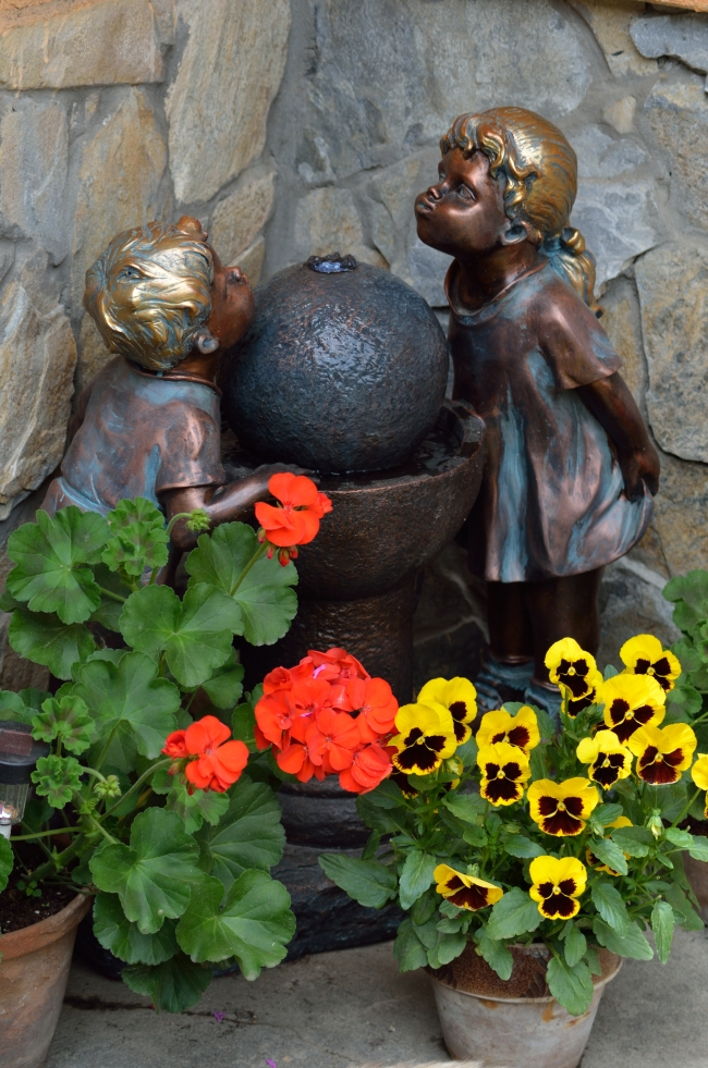 Geraniums near Statue